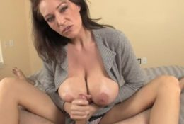 Charlee speaking and jerking a cock on the bed