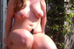 chubby brunette vibrating her pussy outside
