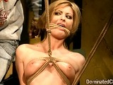 Clamped bondage chick anally fucked