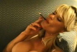 Elegant babe in lingerie likes to tease while smokin'