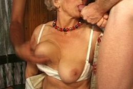Granny has fun with three cocks