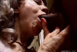 Horny granny sucks black dick with passion