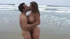 MILF with huge boobs fucking in the beach