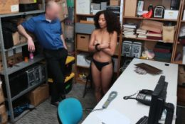 Nia on her knees sucking the officer's cock in the office