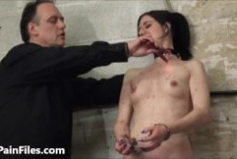 Sexy slave Honesty Cabelleros electro bdsm and hot wax punishment of brunette masochist in kinky bondage in the dungeon