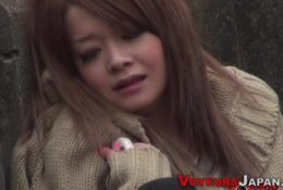 Asian watched toying hairy pussy outdoors