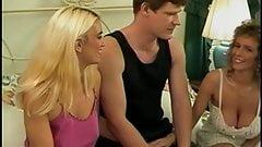 Blonde sucks dude's cock while brunette finger-fucks blonde's pussy
