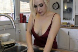 Sexy Gabrielle washing the dishes with downblouse on
