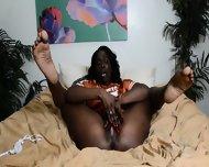 Round Ebony Lady Masturbates