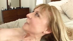 Busty cougar seduces in stockings and a garter