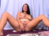 Busty aussie toying her pussy solo