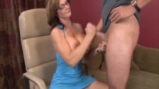 Mature lady stroke a young cock