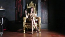 Mistress Kym Smoking and sit on a golden throne