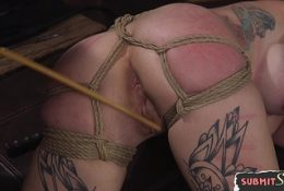 Bigtits sub anally drilled on the bed while restrained