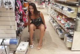 Young girl without panties in a shoe store