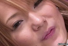 Delightful Japanese fuck doll is playing with a mini vibrato